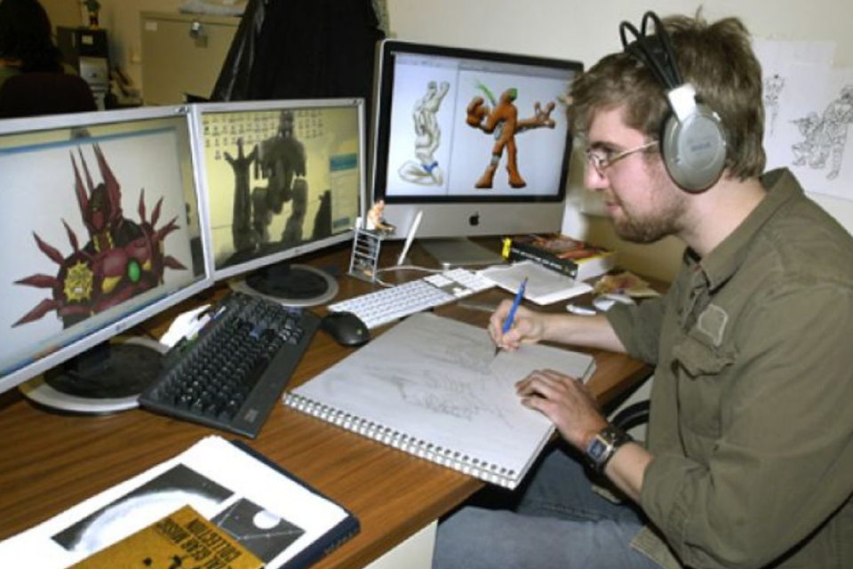 An Image of Game Developer Drawing Some Image In His Notes While Developing Process.