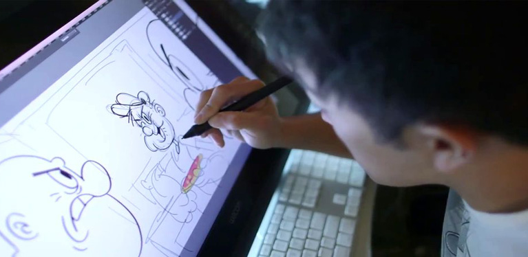 A Person Drawing A Cartoon Image In His Laptop.